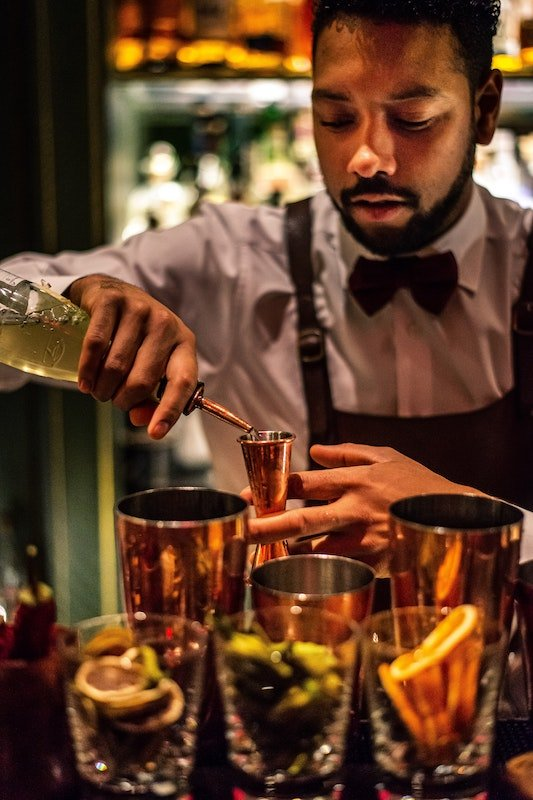 Bartender prepares a cocktail