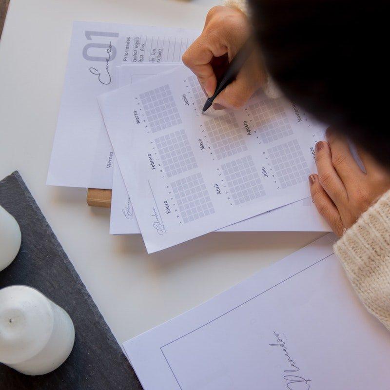 A woman prepares her new calendar
